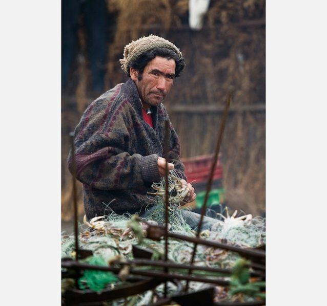 カニ漁師。コブケクラの町近辺、チリ Photo: © Jeff Johnson
